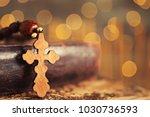 Wooden Cross And Book Against...