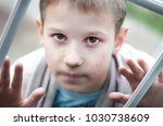 a hungry child looks at you.... | Shutterstock . vector #1030738609