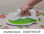 closeup ironing clothes on... | Shutterstock . vector #1030744219