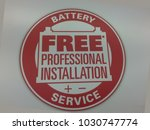 white sign saying battery... | Shutterstock . vector #1030747774