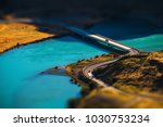 two cars crossing blue river on ... | Shutterstock . vector #1030753234