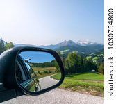 view from the car's mirror in... | Shutterstock . vector #1030754800