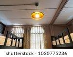 lamp in bedroom hostel | Shutterstock . vector #1030775236