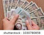 hand counts thai baht money...   Shutterstock . vector #1030780858