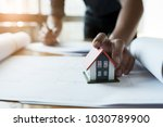 close up hands holding house... | Shutterstock . vector #1030789900