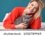 Stock photo young woman with cute pet cat on floor 1030789969