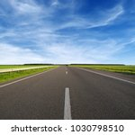 asphalt car road and clouds on... | Shutterstock . vector #1030798510