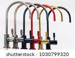 kitchen taps of different... | Shutterstock . vector #1030799320