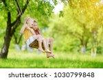 two cute little sisters having... | Shutterstock . vector #1030799848