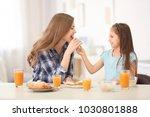 mother with daughter having... | Shutterstock . vector #1030801888