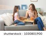 mother with daughter having... | Shutterstock . vector #1030801900