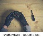 the gloved hands of a man... | Shutterstock . vector #1030813438