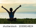 Small photo of Meditation yoga lifestyle woman silhouette on the Sea sunset, relax vital. Healthy Concept
