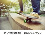 young skateboarder legs riding... | Shutterstock . vector #1030827970