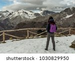 hiking girl admiring mountains  ... | Shutterstock . vector #1030829950