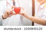 teamwork of doctor hand holding ... | Shutterstock . vector #1030840120