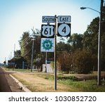 street sign south north in... | Shutterstock . vector #1030852720