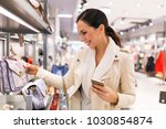 woman shopping for clothes | Shutterstock . vector #1030854874