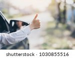 closeup woman driving a car... | Shutterstock . vector #1030855516