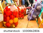 a trolley with pickled tomatoes ...   Shutterstock . vector #1030862806