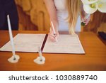 bride signing wedding document... | Shutterstock . vector #1030889740