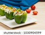 tasty stuffed capsicum.  | Shutterstock . vector #1030904599