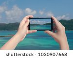 female hand taking picture of...   Shutterstock . vector #1030907668