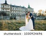 beautiful wedding couple poses... | Shutterstock . vector #1030924696