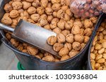 walnuts for sale at a market...   Shutterstock . vector #1030936804