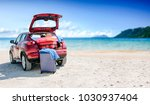 red summer car on beach with... | Shutterstock . vector #1030937404