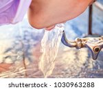 boy is drinking water from a... | Shutterstock . vector #1030963288