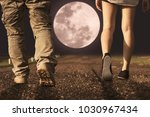 couple walking under full moon... | Shutterstock . vector #1030967434