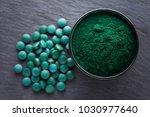 bowls of spirulina algae powder ...   Shutterstock . vector #1030977640