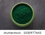 bowls of spirulina algae powder ...   Shutterstock . vector #1030977643