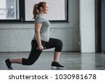 obese girl performing lunges... | Shutterstock . vector #1030981678