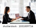 businesspeople man and woman... | Shutterstock . vector #1031009716