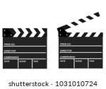 two movie clappers open and... | Shutterstock .eps vector #1031010724