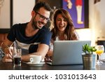 young couple sitting at the... | Shutterstock . vector #1031013643