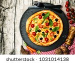 tasty pizza on a the table | Shutterstock . vector #1031014138