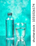 drinking water bottle with glass | Shutterstock . vector #1031026174