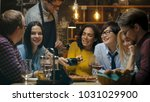 in the bar waiter holds credit... | Shutterstock . vector #1031029900