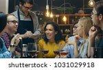 in the bar  restaurant waiter... | Shutterstock . vector #1031029918