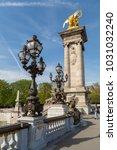 Small photo of Paris, France - March 30, 2017: The Alexander III Bridge across Seine river in Paris, France