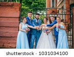 beautiful newlyweds with their... | Shutterstock . vector #1031034100