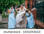beautiful bride and her... | Shutterstock . vector #1031043610