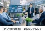 asian businessman gives report  ... | Shutterstock . vector #1031044279