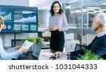 beautiful businesswoman gives... | Shutterstock . vector #1031044333