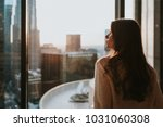 young woman sitting at window  ... | Shutterstock . vector #1031060308