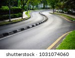 curvy road with divider at... | Shutterstock . vector #1031074060