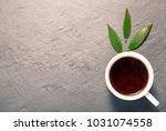 strong black tea in white cup... | Shutterstock . vector #1031074558